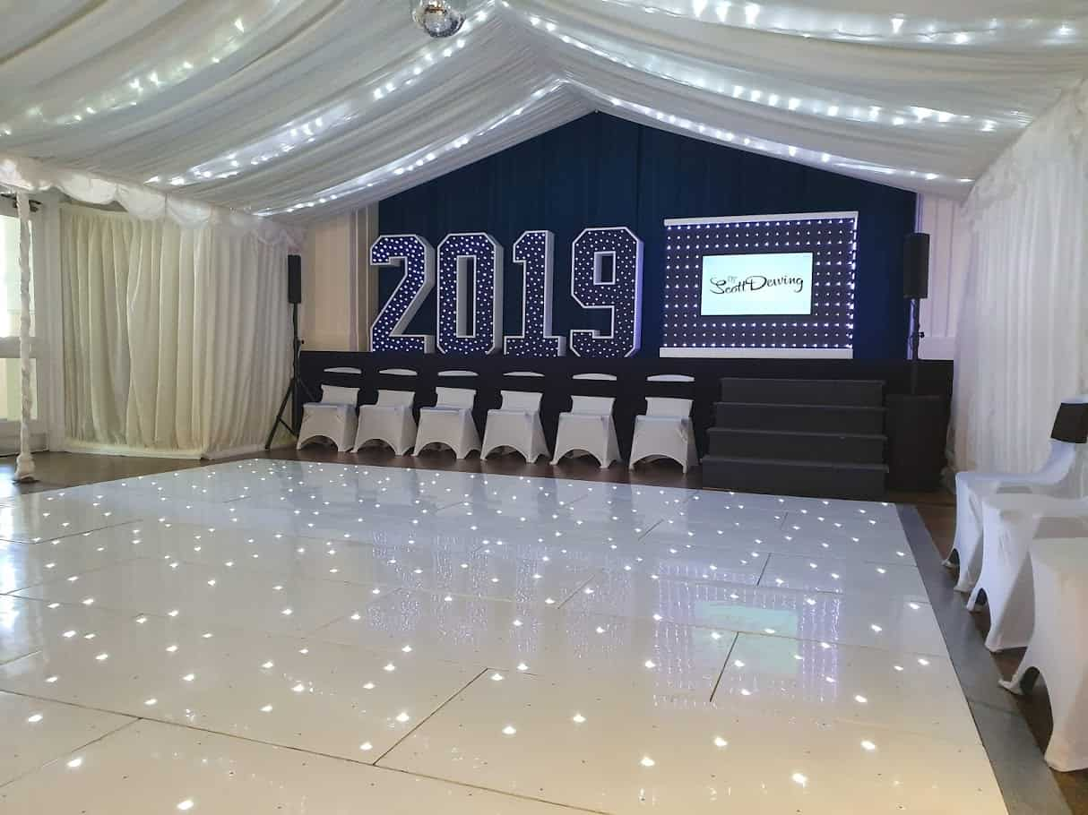 Manningtree High School Prom Setup by Wedding DJ Scott Dewing including Light Up Numbers, Starlit Dancfloor and custom build Video DJ Booth in Manningtree School Hall