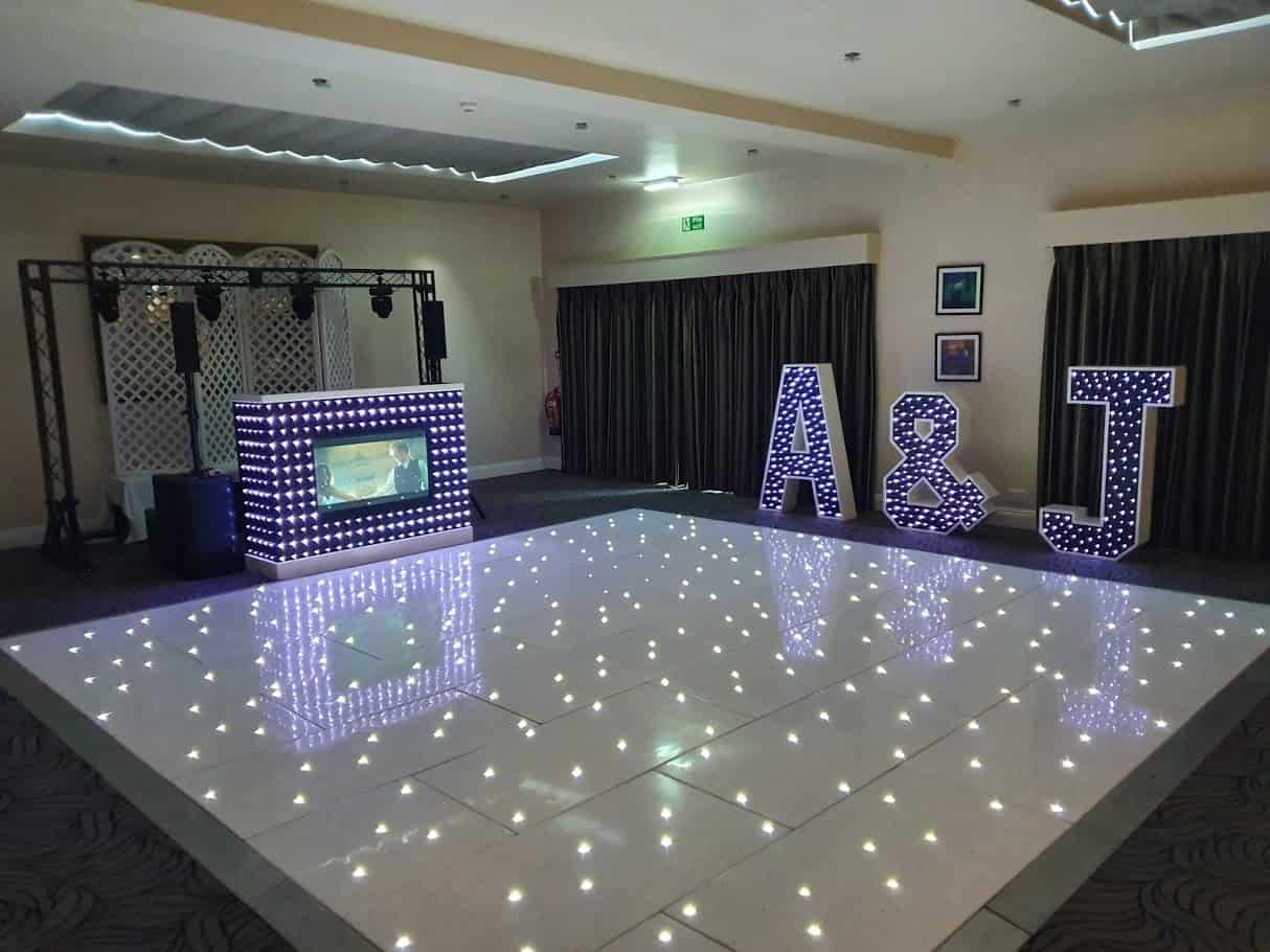 Wedding DJ Scott Dewing supplies Full Wedding Package including Light Up Letters, LED Starlit Dancefloor and custom video DJ booth to Prested Hall, Essex